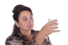 Woman examines a glass. On a white background Stock Photo