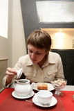 Woman examines tea brewing Stock Photos