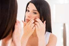 Woman examining face. stock images