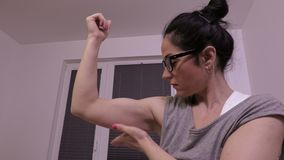Woman examining her muscles stock video