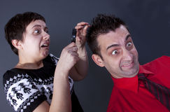 Woman examining man's hair Royalty Free Stock Image