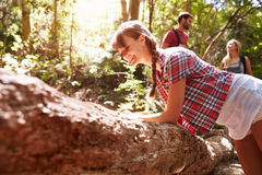 Woman Examining Nature During Walk In Countryside Royalty Free Stock Images
