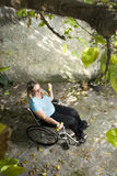 Woman Excercises in Wheelchair Outdoors - Vertical Royalty Free Stock Photo