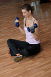 Woman Excercising with Blue Weights Royalty Free Stock Photos