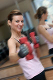 Woman Excercising with Weights Royalty Free Stock Photography