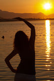 Woman excercising Yoga during sunrise Stock Images