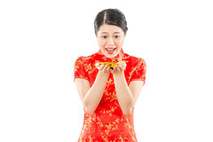 Woman excited holding many gold coins Royalty Free Stock Photo