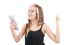 Woman excited looking at touch pad Royalty Free Stock Photo
