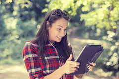 Woman excited looking at touch pad pc Stock Photo
