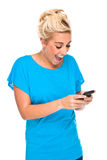 Woman Excited by text message on cell phone Stock Photo