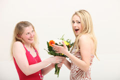 Woman exclaiming over a gift of flowers Royalty Free Stock Photography