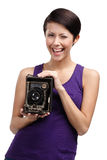 Woman with exclusive photographic camera Royalty Free Stock Image