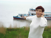 Woman and excursion ship. Royalty Free Stock Photo