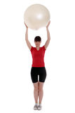 Woman with an exercise ball. Working out Royalty Free Stock Photography