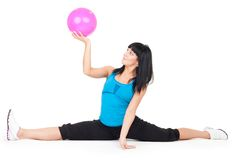 Woman exercise with ball doing splits. On white background Royalty Free Stock Image