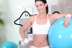 Woman with an exercise ball Royalty Free Stock Images