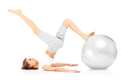Woman and exercise ball Stock Photos