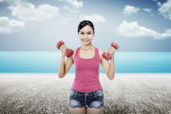 Woman Exercise On The Beach Royalty Free Stock Images