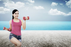 Woman Exercise On The Beach Royalty Free Stock Photo