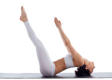 Woman exercise bend yoga pose fish isolated Royalty Free Stock Images