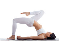 Woman exercise bend yoga pose on rubber mat Royalty Free Stock Photos