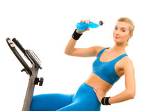 Woman on exercise bicycle Stock Photo