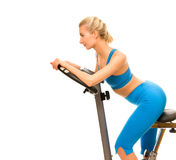 Woman on exercise bicycle Royalty Free Stock Images