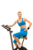 Woman on exercise bicycle Stock Image