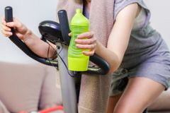 Woman on exercise bike. In room Royalty Free Stock Photography