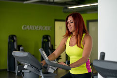 Woman on a Exercise Bike Royalty Free Stock Image