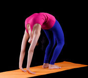 Woman exercise bridge yoga asana  on orange mat Royalty Free Stock Photo