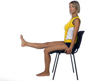 Woman exercise on chair Stock Photography