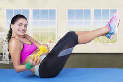 Woman exercise with dumbbell on mattress Royalty Free Stock Photos