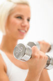 Woman exercise dumbbells white fitness close-up Royalty Free Stock Photo