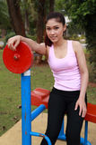 Woman with exercise equipment in the park Stock Images