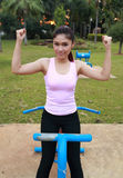 Woman with exercise equipment in the park Royalty Free Stock Image