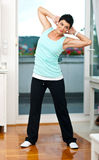 Woman exercise in her home Stock Images