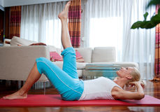Woman exercise in her home Royalty Free Stock Images