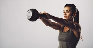 Woman exercise with kettle bell - Crossfit workout royalty free stock photography