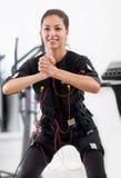 Woman exercise key position  on  electro stimulation machine Stock Photo