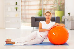 Woman on exercise mat Stock Photography