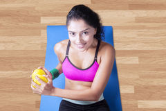 Woman exercise on mattress with dumbbell Stock Image