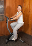 Woman exercise on spinning bicycle Stock Image