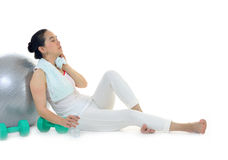 Woman with exercise towel and water Royalty Free Stock Photos