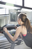 Woman exercise on the treadmill at the gym Stock Photography