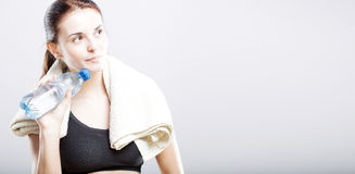 Woman after exercise with water bottle and towel Stock Image