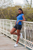 Woman in exercise wear relaxes on bridge Royalty Free Stock Photography