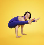 Woman exercise yoga arm balance and smile Royalty Free Stock Image