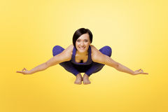 Woman exercise yoga arm balance and smile Stock Photo