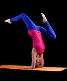 Woman exercise yoga asana - arm balance Stock Photos